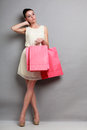 Woman Holding Red Paper Shopping Bags Stock Photo - 50312450