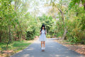 A Cute Asian Thai Girl Is Standing On A Forest Path Alone Stock Image - 50318061