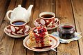 Russian Bliny With Currant Jam, Tea Cups, Pot On Wooden Backgrou Stock Photo - 50328630
