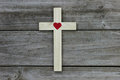 Wood Cross With Red Heart On Rugged Wooden Background Stock Photos - 50338443