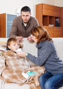 Man And Woman Caring For Sick Boy Royalty Free Stock Images - 50359119