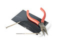 Pliers And Screwdriver Over The Broken Phone Stock Photo - 50360350