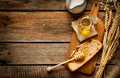 Honey In A Jar, Slice Of Bread, Wheat And Milk On Vintage Wood Stock Image - 50370331