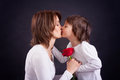 Young Kid Giving Gorgeous Red Rose To His Mom Royalty Free Stock Photography - 50376517