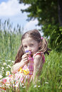 Young Girl Smelling Flowers Royalty Free Stock Image - 50379356