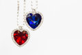 Two Jewelry Hearts Blue And Red Hanging Together Stock Photography - 50391332