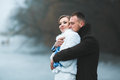 Beautiful Couple On The Dock In The Winter Fog. Stock Photo - 50459710