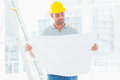 Male Architect Reading Blueprint In Office Royalty Free Stock Photo - 50478475