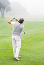Golfer Swinging His Club On The Course Royalty Free Stock Photography - 50484927