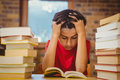 Tensed Boy Sitting With Stack Of Books Stock Photos - 50485383