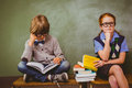 Kids With Stack Of Books In Classroom Royalty Free Stock Photos - 50487418
