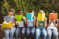 Children Reading Books At Park Royalty Free Stock Photo - 50487545