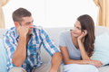 Couple Discussing On Sofa Stock Image - 50493321