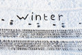 Word Winter And Tire Tracks In Snow On Road Stock Photo - 50511330