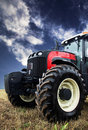 Tractor Harvesting A Wheat Field Stock Image - 50515861
