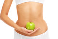 Green Apple Over Belly Royalty Free Stock Photos - 50520618