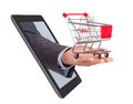 Hand With Shopping Cart Coming From Tablet Royalty Free Stock Photos - 50538268