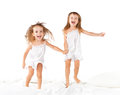 Happy Family .  Kids Twin Sisters Jumping On The Bed, Playing An Stock Images - 50543974