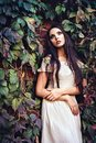 Beautiful Young Girl In White Dress Standing Among Colorful Leaves Royalty Free Stock Images - 50548869