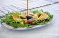 Ruccola Salad With Orange, Cheese, Sesame And Balsamic Stock Photo - 50553150