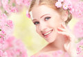 Beauty Face Of Young Happy Beautiful Woman With Pink Flowers In Royalty Free Stock Photo - 50554865