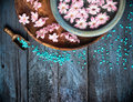 Scoop With Sea Salt Bowl And Flowers In Water On Blue Wooden Table, SPA Background Royalty Free Stock Photo - 50566195