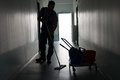 Man With Broom Cleaning Office Corridor Stock Photos - 50572053