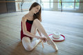 Young Ballerina Sitting On The Floor Dance Classroom Stock Photography - 50578782