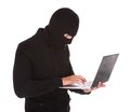 Burglar Using Laptop Stock Photography - 50579402