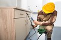 Pest Control Worker Spraying Pesticides Stock Photography - 50583062