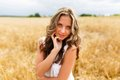 Young Beautiful Girl In A Wheat Field Stock Image - 50594481