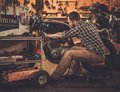 Mechanic Building Vintage Style Cafe-racer Motorcycle Royalty Free Stock Images - 50595739