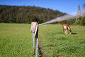 Cowboy Hat And Whip Resting On Fence Post - Horse In Background. Royalty Free Stock Photography - 50600827