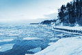 Winter Coastal Landscape With Floating Ice And Frozen Pier Stock Photography - 50609762
