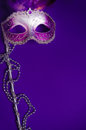Purple Mardi-Gras Or Venetian Mask On Purple Background Stock Images - 50620034