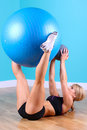 Young Woman Sit Up With Ball Royalty Free Stock Image - 50621766