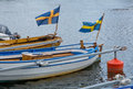 Two Boats With Swedish Flags Stock Image - 50626171