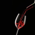 Pouring Red Wine Into Wine Glass Royalty Free Stock Images - 50628489