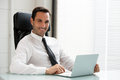 Businessman Working With A Laptop Computer Stock Image - 50652021