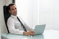 Businessman With Earphones And Laptop Computer Royalty Free Stock Photography - 50652887