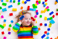 Little Girl Playing With Toy Blocks Royalty Free Stock Photo - 50668725