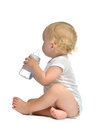 Infant Child Baby Toddler Sitting And Drinking Water From The Fe Stock Photo - 50676310