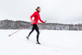 Cross-country Skiing: Young Woman Cross-country Skiing Stock Images - 50684404