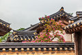 Traditional Old Korean Building With Tree And Flowers Royalty Free Stock Photography - 50697947