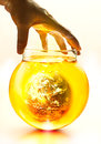 Earth Burning In The Bottle And Yellow Water Boil Under Hand, Environment Concept-Earth Original Image From NASA Royalty Free Stock Photo - 50699485