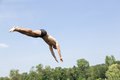 Man Jumping Off Diving Board At Swimming Pool Stock Image - 50700591