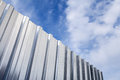 Shining Corrugated Metal Fence And Blue Cloudy Sky Stock Photos - 50730543