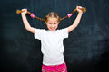 Girl In A White T-shirt Lifted Pigtails Stock Photos - 50750653
