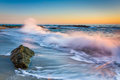 Waves Crashing On Rocks At Sunset, At Victoria Beach  Royalty Free Stock Photo - 50755775