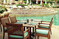 Table And Chairs In Outdoor Cafe Next To The Resort Swimming Poo Stock Image - 50760701